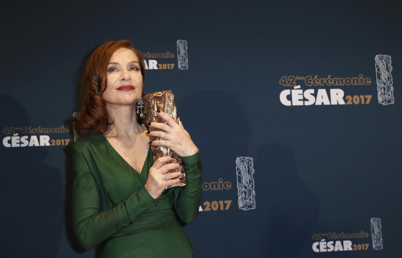 "Actress Isabelle Huppert holds her trophy during a photocall after receiving the Best Actress Award for her role in the film ""Elle"" at the 42nd Cesar Awards ceremony in Paris, France, February 24, 2017.         REUTERS/Gonzalo Fuentes  TPX IMAGES OF THE DAY"