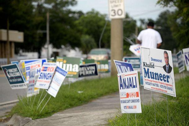 PHOTO: Candidate signs are viewed along a street across from an early voting location at the Supervisor of Elections office, Aug. 13, 2020, in Orlando, Fla. (Phelan M. Ebenhack/AP, FILE)