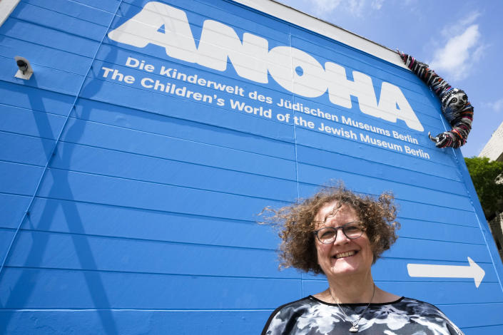 Ane Kleine-Engel, the head of the children's museum at the Jewish Museum pose in front of the entrance of the museum in Berlin, Germany, Monday, June 21, 2021. The Jewish Museum of Berlin is opening a new museum for children between the ages of three and ten.(AP Photo/Markus Schreiber)