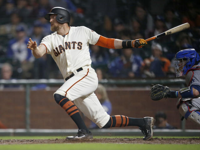 FILE - In this Tuesday, Sept. 12, 2017 file photo, San Francisco Giants' Hunter Pence hits a single to drive in a run against the Los Angeles Dodgers during the sixth inning of a baseball game in San Francisco. Hunter Pence has agreed to a minor league contract with his hometown Texas Rangers and will attend major league spring training. General major Jon Daniels said Thursday, Feb. 7, 2019 that the 35-year-old outfielder, who played winter ball, has a long track record of being a great teammate and is a winning player.(AP Photo/Tony Avelar, File)