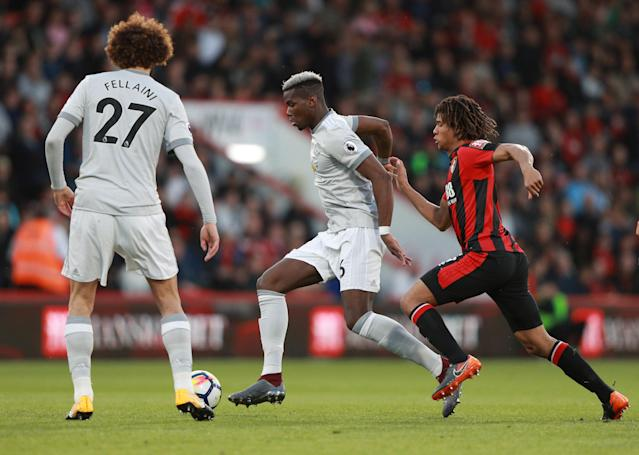 """Soccer Football - Premier League - AFC Bournemouth vs Manchester United - Vitality Stadium, Bournemouth, Britain - April 18, 2018 Manchester United's Paul Pogba in action with Bournemouth's Nathan Ake REUTERS/Ian Walton EDITORIAL USE ONLY. No use with unauthorized audio, video, data, fixture lists, club/league logos or """"live"""" services. Online in-match use limited to 75 images, no video emulation. No use in betting, games or single club/league/player publications. Please contact your account representative for further details."""