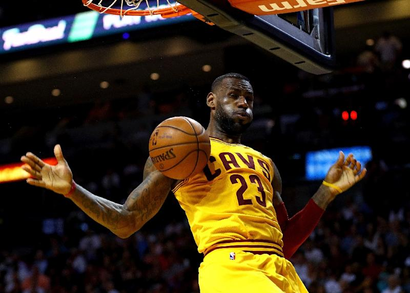 992ba1229431 Cleveland Cavaliers forward LeBron James dunks during a game against the  Miami Heat on March 19