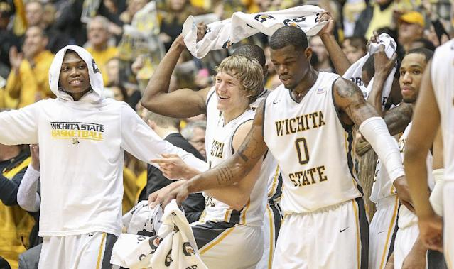 The Wichita State basketball team celebrates beating Missouri State 68-45 to end a perfect 31-0 season after an NCAA college basketball game in Wichita, Kan., Saturday, March 1, 2014. (AP Photo/The Wichita Eagle, Fernando Salazar) LOCAL TV OUT; MAGS OUT; LOCAL RADIO OUT; LOCAL INTERNET OUT
