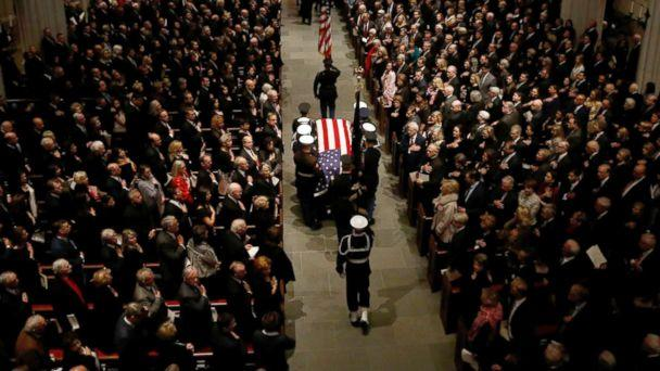 PHOTO: The flag-draped casket of former President George H.W. Bush is carried by a joint services military honor guard into St. Martin's Episcopal Church, Dec. 6, 2018, in Houston. (Mark Humphrey/AP)