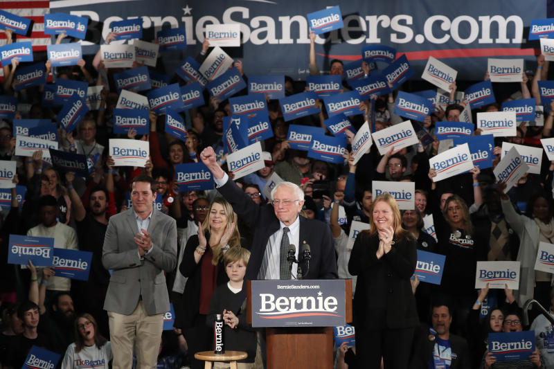 Democratic presidential candidate Sen. Bernie Sanders, I-Vt., with his wife Jane O'Meara Sanders, right, and other family members, speaks at a caucus night campaign rally in Des Moines, Iowa, Monday, Feb. 3, 2020. (AP Photo/Pablo Martinez Monsivais)