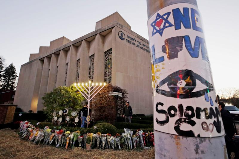 A menorah at a memorial outside the Tree of Life Synagogue, where Robert Bowers killed worshippers in an Oct. 27 shooting, as people prepare for a celebration service at sundown on the first night of Hanukkah in the Squirrel Hill neighborhood of Pittsburgh.