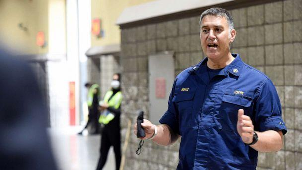 PHOTO: Cmdr. Nick Munoz of the Office of the Assistant Secretary for Preparedness and Response speaks to city officials about the medical care migrant children will receive at the Long Beach Convention Center on April 22, 2021 in Long Beach, Calif.  (Pool/Getty Images, FILE)