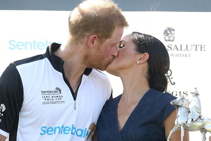 Prince Harry and Meghan Markle kiss at a polo match in July 2018.