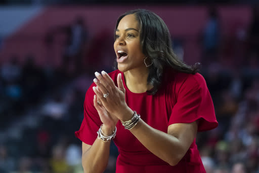 "File-This Nov. 17, 2019, file photo shows Georgia coach Joni Taylor shouting to players during an NCAA women's basketball game against Georgia Tech in Athens, Ga. The Georgia Lady Bulldogs are back in the Top 25. Thats a part of Georgia basketball. Thats the expectation, coach Joni Taylor said Tuesday. ""You can't walk into the building and not be reminded of who we are, the program's history, and what we're trying to carve out in terms of women's basketball. That's a huge motivator for me, my entire staff, and all the ladies we bring in to play here. (AP Photo/John Amis, File)"