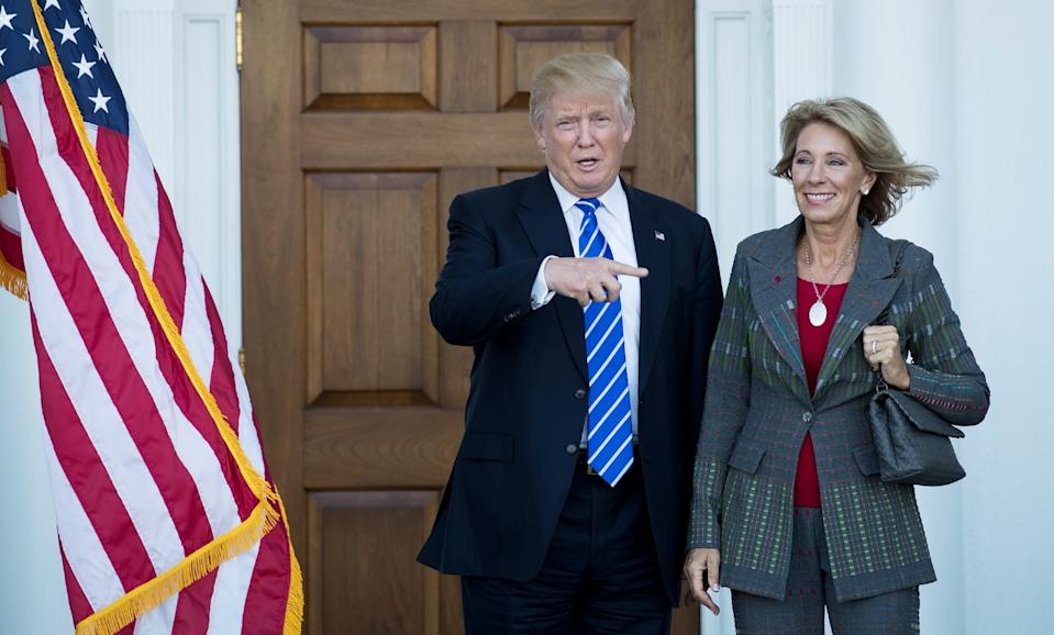 President-elect Donald Trump and Betsy DeVos pose for a photo after their meeting at Trump International Golf Club, November 19, 2016 in Bedminster Township, New Jersey. (Photo: Drew Angerer/Getty Images)