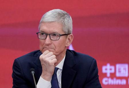 FILE PHOTO: Apple CEO Tim Cook attends the annual session of CDF 2018 in Beijing