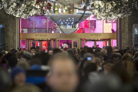 File photo of shoppers entering Macy's to kick off Black Friday sales in New York