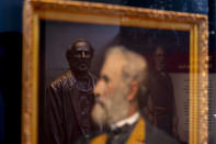 A statue, photographs, and paintings of Robert E. Lee are displayed at a museum building at Arlington House, The Robert E. Lee Memorial, formerly named the Custis-Lee Mansion, which reopens to the public for the first time since 2018 at Arlington National Cemetery, Tuesday, June 8, 2021 in Arlington, Va. The Virginia mansion where Robert E. Lee once lived that now overlooks Arlington National Cemetery is open to the public again, after a $12 million rehabilitation and reinterpretation that includes an increased emphasis on those who were enslaved there. (AP Photo/Andrew Harnik)