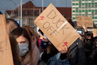 """Demonstrators hold signs during protest against imposing further restrictions on abortion law in Gdansk, Poland October 24, 2020. Back sign reads, """"My body, my choice"""". REUTERS/Peter Pawlowski"""