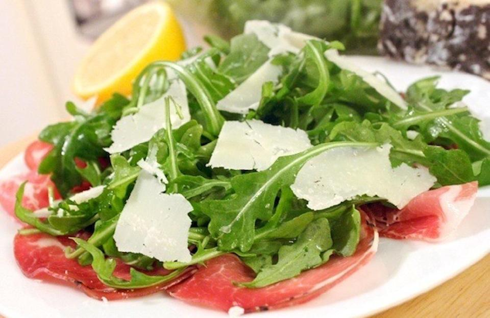 """<p>Salads are great, but sometimes it's hard to find a recipe for one that doesn't require a bunch of ingredients. This arugula salad recipe keeps things simple but has the perfect blend of salty, citrusy and sharp flavors.</p> <p><a href=""""https://www.thedailymeal.com/arugula-salad-coppa-and-pecorino-recipe?referrer=yahoo&category=beauty_food&include_utm=1&utm_medium=referral&utm_source=yahoo&utm_campaign=feed"""" rel=""""nofollow noopener"""" target=""""_blank"""" data-ylk=""""slk:For the Arugula Salad With Coppa and Pecorino recipe, click here."""" class=""""link rapid-noclick-resp"""">For the Arugula Salad With Coppa and Pecorino recipe, click here.</a></p>"""