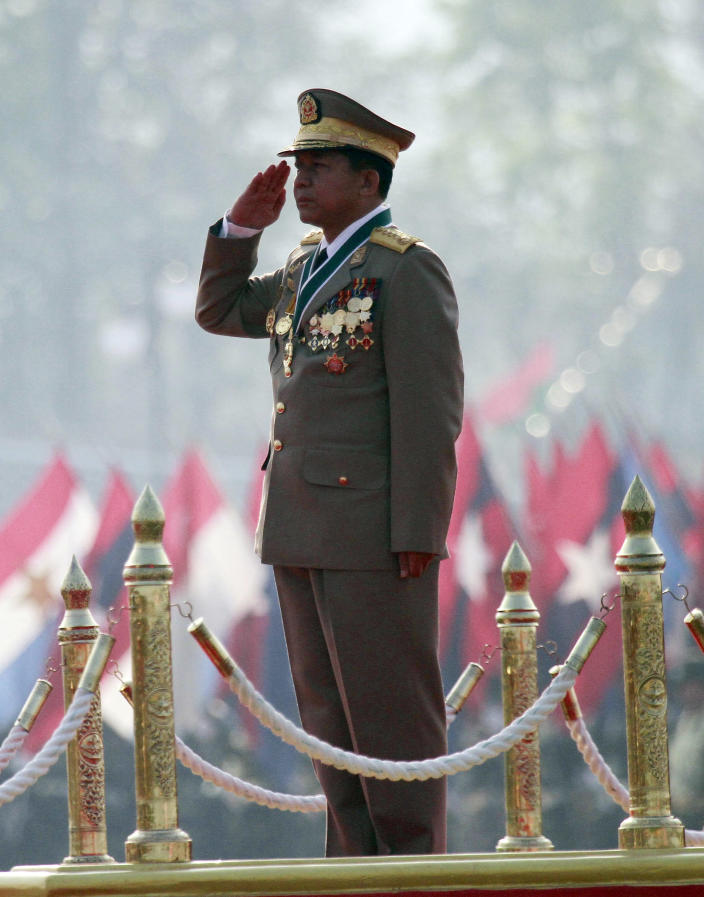 Myanmar's Gen. Min Aung Hlaing, Myanmar salutes the national flag during a ceremony marking the country's 67th Armed Forces Day in Naypyitaw, Myanmar, on Tuesday, March 27, 2012. (AP Photo/Khin Maung Win)