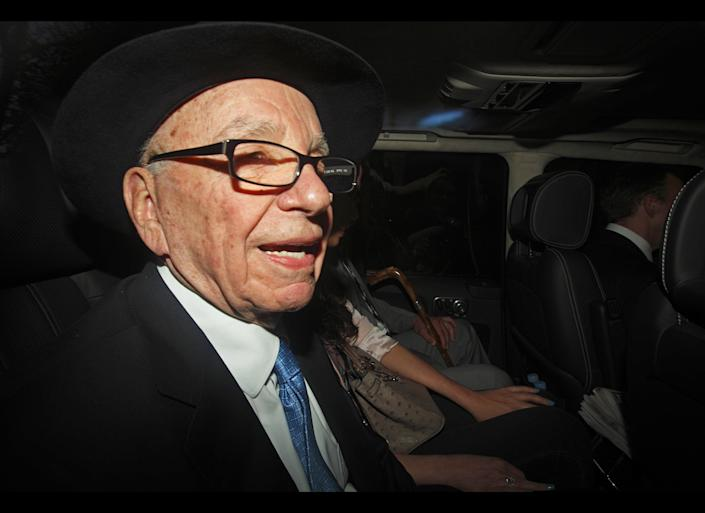 News Corp Chief Rupert Murdoch (L) is driven away from the High Court in central London on April 26, 2012 after Rupert Murdoch's second and final day of giving evidence at the Leveson Inquiry. Rupert Murdoch admitted on April 26 there was a 'cover-up' over phone hacking at Britain's News of the World tabloid but tried to shift the blame away from himself and senior executives at his media empire. AFP PHOTO / JUSTIN TALLIS (Photo credit should read JUSTIN TALLIS/AFP/GettyImages)