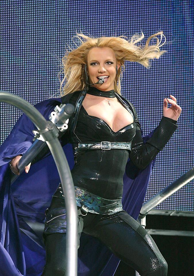 Britney Spears  It's one thing to have a super hero-inspired look (as per Fergie), but it's another thing to look like you actually believe you can fly. Britney Spears' 2004 tour ensemble could've been another sexy on-stage look, but the addition of a full-on cape made the singer look a little too insane.