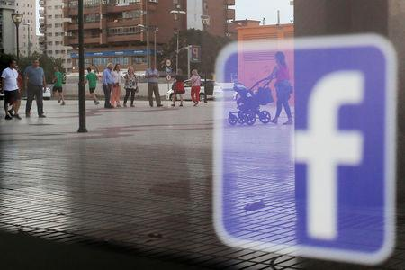Facebook logo is seen on a shop window in Malaga