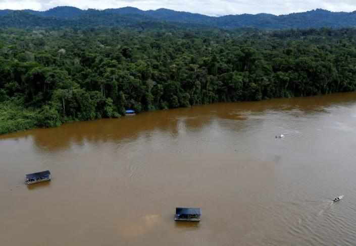 FILE PHOTO: A gold dredge is seen at the banks of Uraricoera River during Brazil's environmental agency operation against illegal gold mining on indigenous land, in the heart of the Amazon rainforest