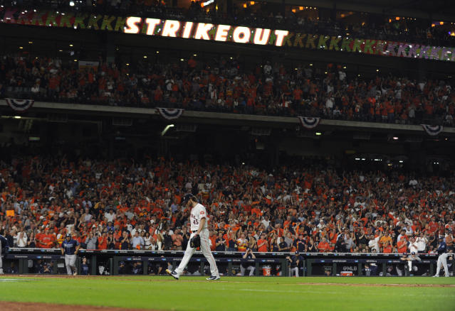 Houston Astros starting pitcher Gerrit Cole walks off the field after the sixth inning of Game 5 of the baseball team's American League Division Series against the Tampa Bay Rays in Houston, Thursday, Oct. 10, 2019. (AP Photo/Eric Christian Smith)