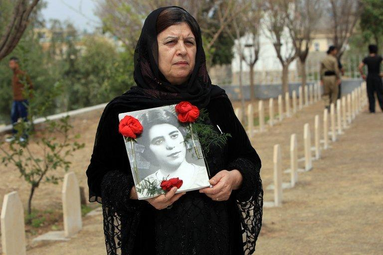 An Iraqi Kurdish woman visits the grave of her sister in the Kurdish town of Halabja, on March 16, 2013