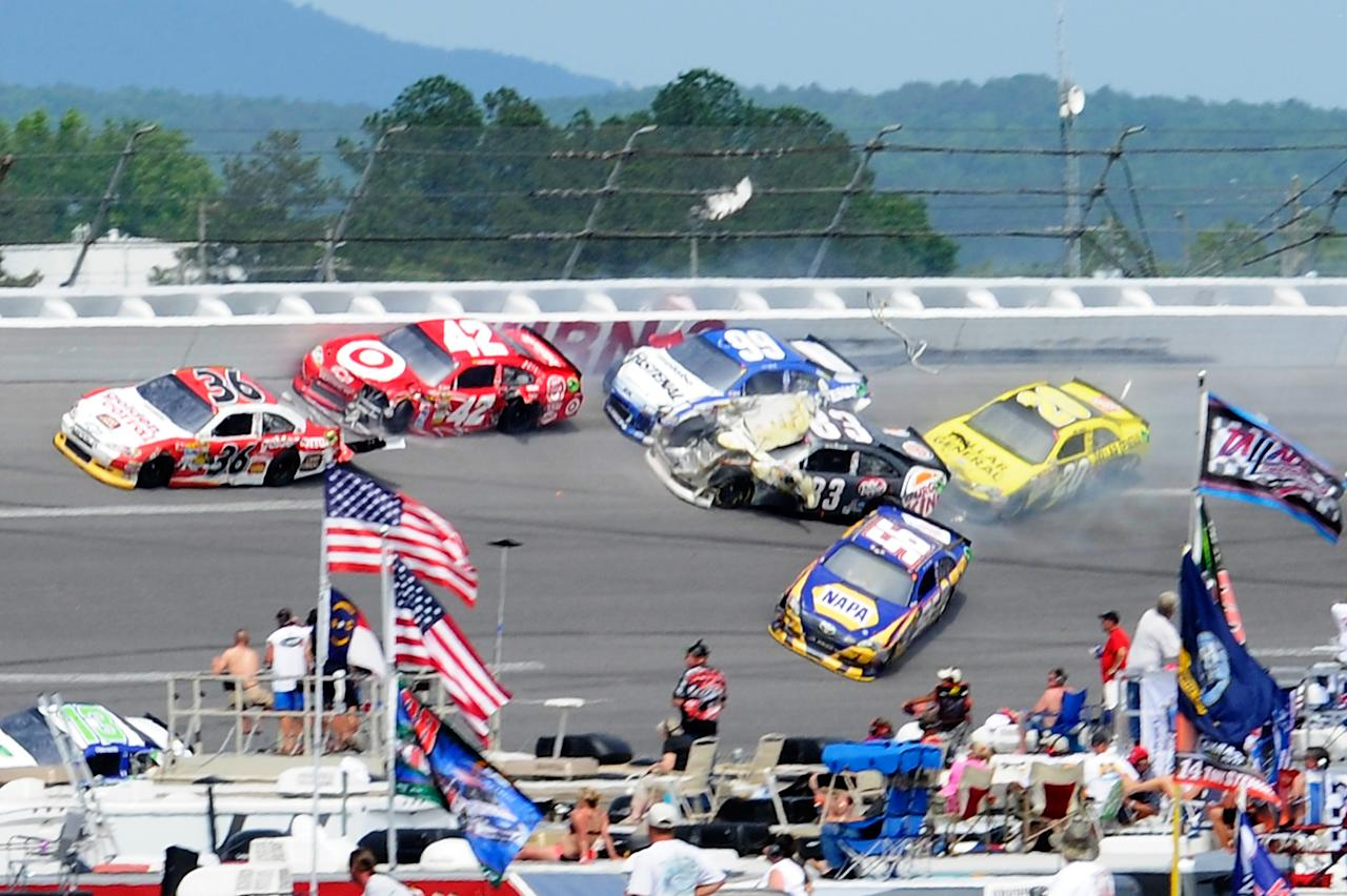 TALLADEGA, AL - MAY 06:  Dave Blaney, driver of the #36 Golden Corral Chevrolet, Juan Pablo Montoya, driver of the #42 Target/Kraft Chevrolet, Carl Edwards, driver of the #99 Fastenal Ford, Landon Cassill, driver of the #83 Burger King Toyota, Martin Truex Jr., driver of the #56 NAPA Auto Parts Toyota, and Joey Logano, driver of the #20 Dollar General Toyota, are involved in an incident during the NASCAR Sprint Cup Series Aaron's 499 at Talladega Superspeedway on May 6, 2012 in Talladega, Alabama.  (Photo by John Harrelson/Getty Images for NASCAR)