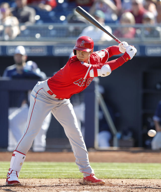 Los Angeles Angels' Shohei Ohtani avoids an inside pitch during the third inning of a spring training baseball game against the San Diego Padres, Monday, Feb. 26, 2018, in Peoria, Ariz. (AP Photo/Charlie Neibergall)