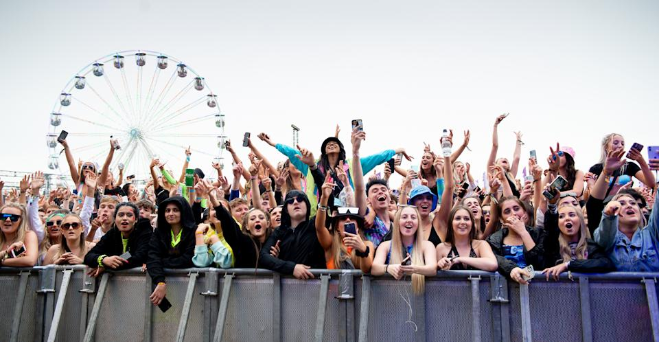 MANCHESTER, ENGLAND - SEPTEMBER 12: Audience members watch Becky Hill perform during Parklife at Heaton Park on September 12, 2021 in Manchester, England. (Photo by Shirlaine Forrest/WireImage)