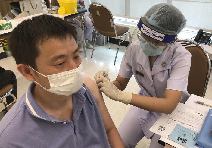 A health worker administers a dose of the Sinovac COVID-19 vaccine to Zhang Xiaohong, a 40-year-old businessman who runs a logistic company in Thailand, at Bangrak Vaccination and Health Center in Bangkok, Thailand Thursday, May 20, 2021. China began vaccinating its citizens living in Thailand on Thursday as part of a global campaign to inoculate its nationals living and working abroad. (AP Photo/Fu Ting)