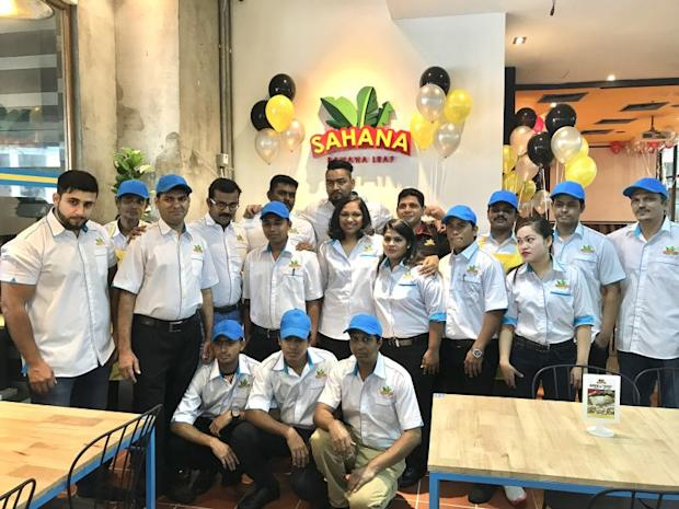 Sathiyah (in the middle) posing with some of her staff, including refugees, at her new banana leaf restaurant in Kuala Lumpur. ― Picture by A. Ruban