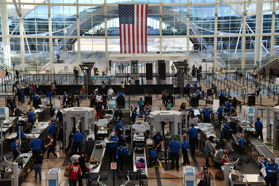 Photo of busy terminal at Denver International Airport.
