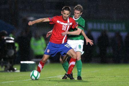 FILE PHOTO - Football - Northern Ireland v Serbia - UEFA Euro 2012 Qualifying Group C - Windsor Park, Belfast, Northern Ireland - 2/9/11 Steven Davis (R) - Northern Ireland in action against Milos Ninkovic - Serbia Mandatory Credit: Action Images / Andrew Couldridge