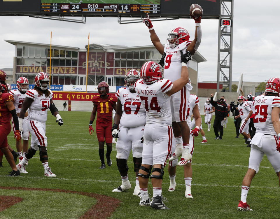Running back Trey Ragas #9 of the Louisiana-Lafayette Ragin Cajuns is lifted into the air by Max Mitchell #74 after he scored a TD against Iowa State on Saturday. (David K Purdy/Getty Images)