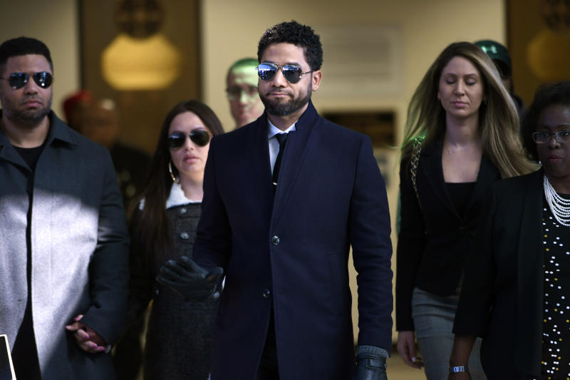 FILE - In this March 26, 2019 file photo, actor Jussie Smollett gestures as he leaves Cook County Court after his charges were dropped in Chicago.  Smollett faces new charges for reporting an attack that Chicago authorities contend was staged to garner publicity, according to media reports Tuesday, Feb. 11, 2020. The charges include disorderly conduct counts, according to the reports that cite unidentified sources.  (AP Photo/Paul Beaty, File)