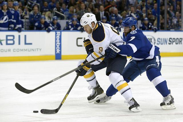 Buffalo Sabres center Steve Ott (9) gets past Tampa Bay Lightning defenseman Radko Gudas (7) to attempt a shot on-goal during the first period of an NHL hockey game in Tampa, Fla., Saturday, Oct. 26, 2013. (AP Photo/Phelan M. Ebenhack)