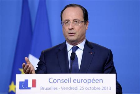 France's President Hollande addresses a news conference at an European Union leaders summit in Brussels