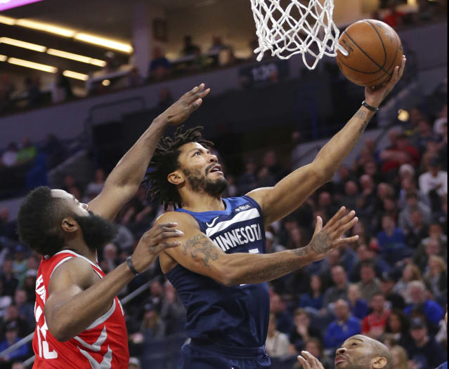 Minnesota Timberwolves Derrick Rose (25) shoots over Houston Rockets guard James Harden (13) in the first quarter of an NBA basketball game Sunday, March 18, 2018, in Minneapolis. (AP Photo/Andy Clayton-King)