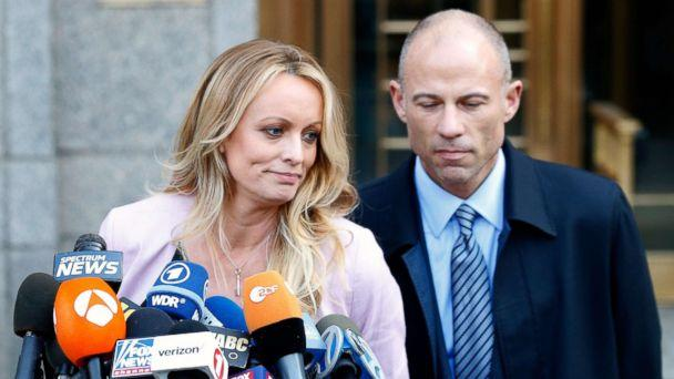 PHOTO: Adult film actress Stephanie Clifford, also known as Stormy Daniels, speaks to media along with lawyer Michael Avenatti (R) outside federal court in New York, April 16, 2018. (Brendan Mcdermid/Reuters)