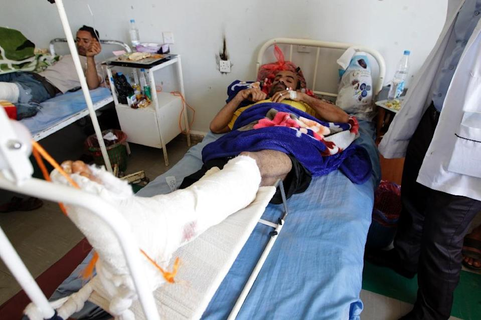 A Yemeni man recovers in hospital in the capital Sanaa on April 21, 2015, after he was wounded in Saudi-led air strikes the previous day (AFP Photo/Mohammed Huwais)