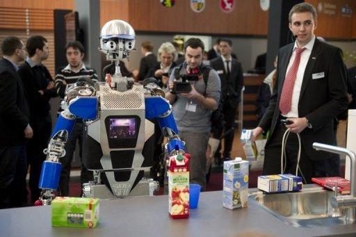 A robot said to be able to cook on display at CeBIT, the world's biggest high-tech fair in Hanover