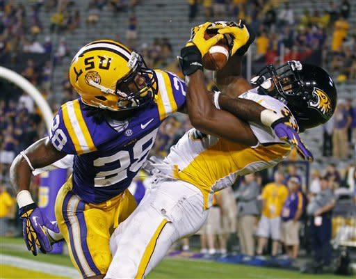 Towson wide receiver Gerrard Sheppard (33 ) catches a touchdown pass against LSU cornerback Jalen Mills (28) in the second half of an NCAA college football game in Baton Rouge, La., Saturday, Sept. 29, 2012. LSU defeated Towson 38-22. (AP Photo/Bill Haber)