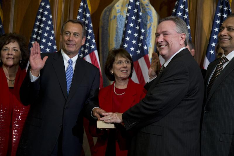 FILE - In this Thursday, Jan. 3, 2013, file photo, U.S. Rep. Steve Stockman, R-Texas, second from right, participates in a mock swearing-in ceremony with Speaker of the House Rep. John Boehner, R-Ohio, for the 113th Congress on in Washington. In a last-minute surprise late Monday, Dec. 9, 2013, Stockman filed paperwork to challenge fellow Texas Republican and powerful incumbent John Cornyn for the U.S. Senate next year. (AP Photo/ Evan Vucci, File)
