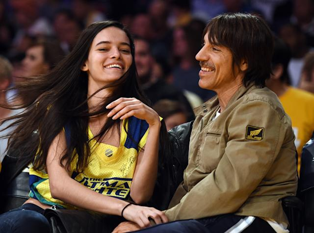 <p>Wanessa Milhomem and Anthony Kiedis of The Red Hot Chili Peppers sit court-side during the Lakers v. Hawks game in 2015. </p>