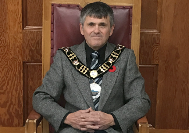 Port aux Basques Mayor John Spencer said he was disappointed by a recent report from Marine Atlantic that would impact the corporation moving it's headquarters into the community. (Town of Port aux Basques website - image credit)