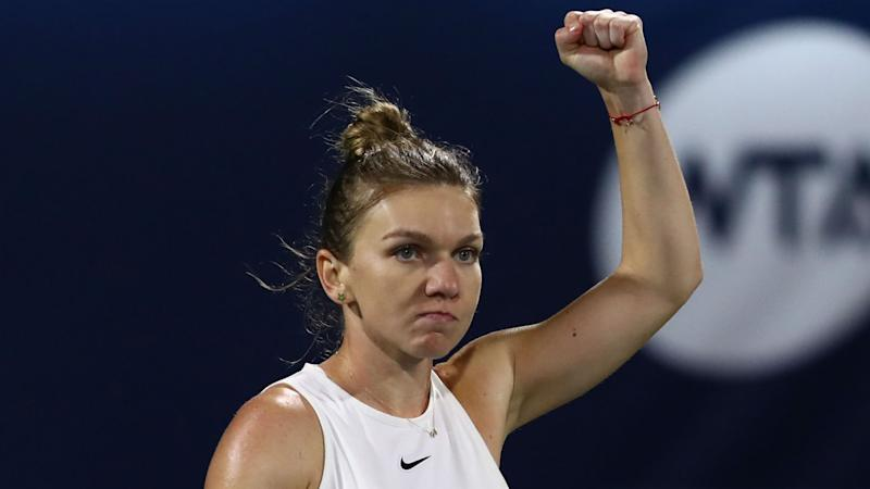 Halep fights back to tee up Brady semi-final in Dubai