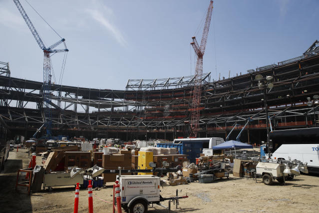 Construction continues at the Los Angeles Rams' new NFL football stadium Thursday, June 14, 2018, in Inglewood, Calif. Rams coach Sean McVay scrapped the final practice of minicamp on Thursday and took his players and coaches on a tour of their multibillion-dollar stadium, which will open for the 2020 season. (AP Photo/Jae C. Hong)
