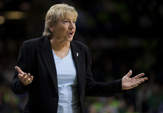 """FILE - In this Feb. 1, 2018, file photo, North Carolina coach Sylvia Hatchell questions a call during the second half of the team's NCAA college basketball game against Notre Dame in South Bend, Ind. Hatchell has resigned after an external review found she had made """"racially insensitive"""" comments and applied """"undue influence"""" regarding players' ability to compete through medical issues. The school issued a release late Thursday, April 18, 2019, announcing the Hall of Famer's resignation and findings from the review by a Charlotte-based law firm. The review also reported """"a breakdown of connectivity between the players and Hatchell"""" after 28 interviews of current players and program personnel. (AP Photo/Robert Franklin, File)"""