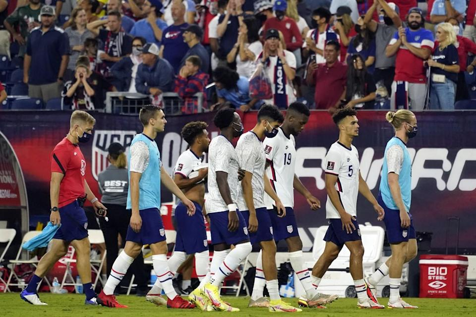 Members of the U.S. soccer team leave the pitch following a 1-1 draw against Canada.