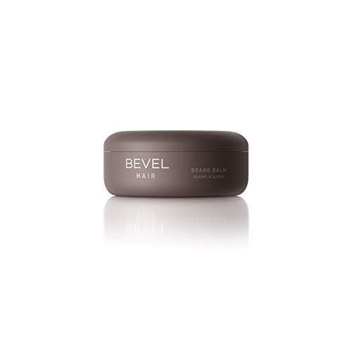 """<p><strong>Bevel</strong></p><p>amazon.com</p><p><strong>$11.99</strong></p><p><a href=""""https://www.amazon.com/dp/B07DHW3DLP?tag=syn-yahoo-20&ascsubtag=%5Bartid%7C2141.g.29492086%5Bsrc%7Cyahoo-us"""" rel=""""nofollow noopener"""" target=""""_blank"""" data-ylk=""""slk:Shop Now"""" class=""""link rapid-noclick-resp"""">Shop Now</a></p><p>When cold weather and quarantine combine forces, it's almost guaranteed that dad will be rocking a beard this winter. Bevel's top-rated Beard Balm will prevent it from getting too scraggly with shea butter, almond oil, and coconut oil.</p>"""